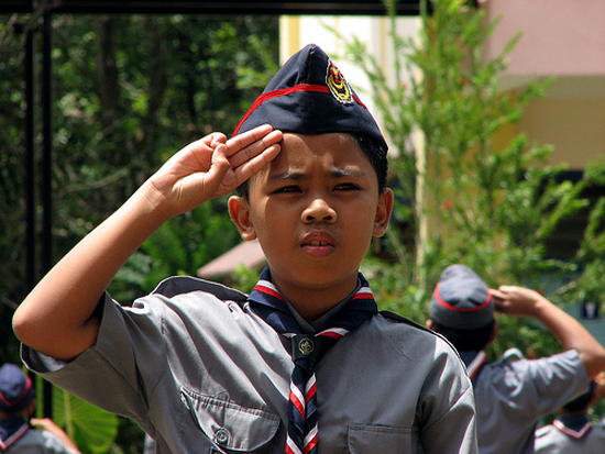 Boy Scout making the Scout salute