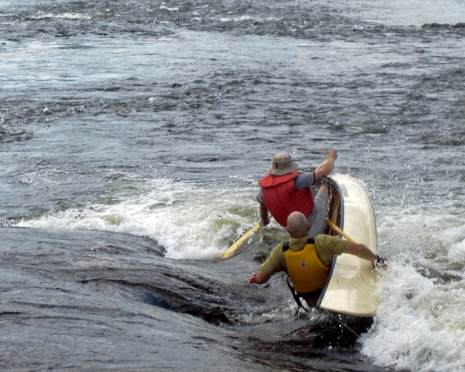 Canoe capsizing with two men falling out