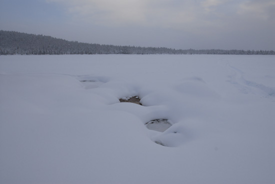 Open water on a frozen river in the boreal forest