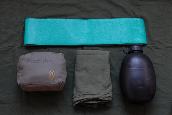 Wilderness First Aid Kit packed in pouch, alongside other useful outdoor first aid items.