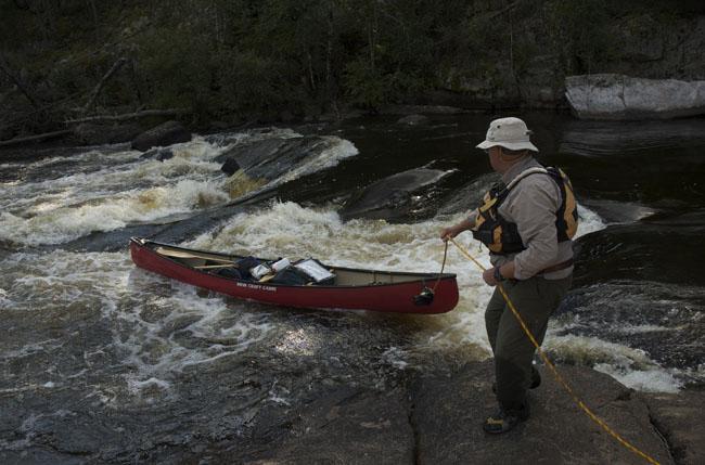 Ray Goodwin lining a canoe