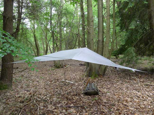 A lightweight tarp provides good ground coverage
