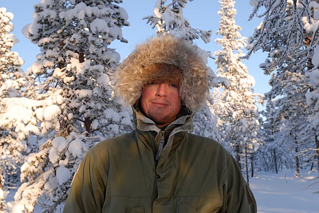 Paul Kirtley wearing warmest hat and jacket hood at thirty below in northern Sweden.