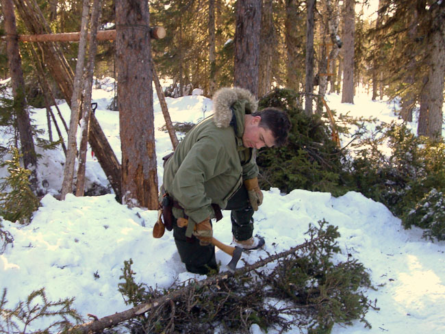 Paul Kirtley using axe in boreal forest