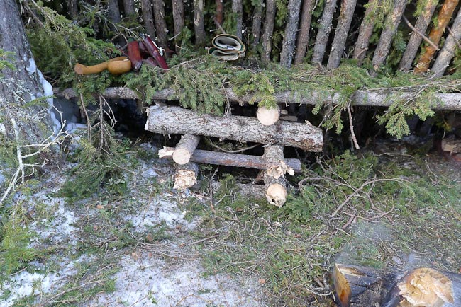 Log stack to creat platform for raised bed
