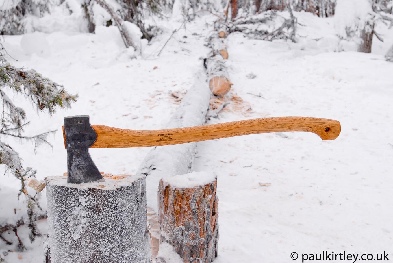Gransfors Bruk Scandinavian Forest three-quarter length axe in snowy forest tree stump