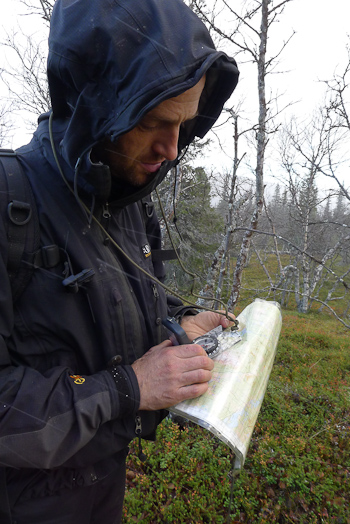 Man using map and compass