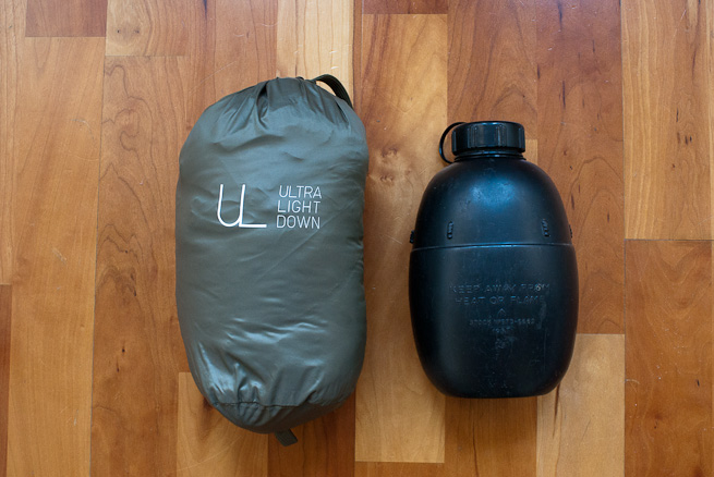 Stuffed UNIQLO Ultra Light Down gilet and waterbottle for size comparison.