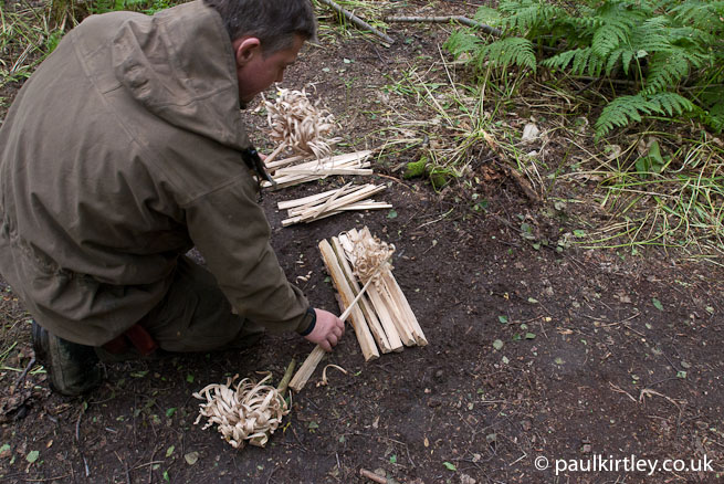 Paul Kirtley laying down feathersticks