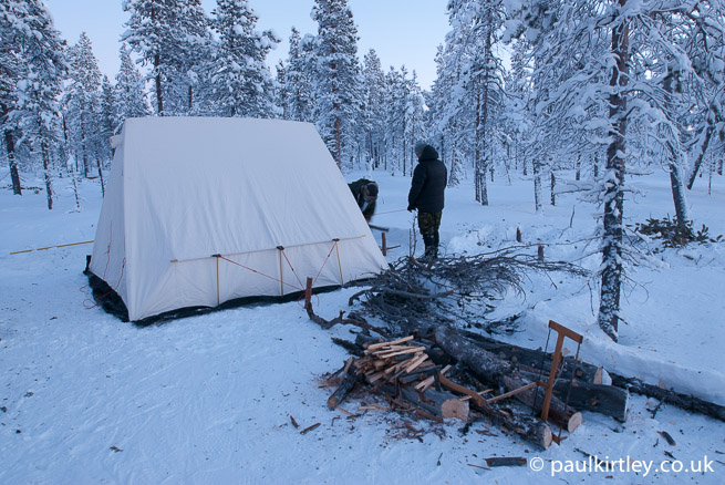 Firewood processing area in front of tent