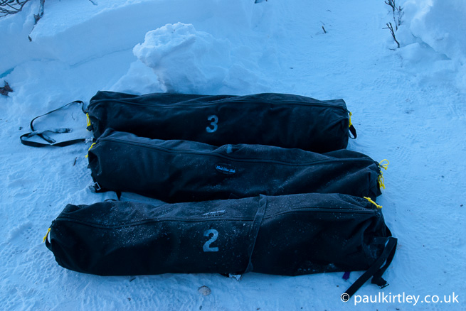 Duffel bags in snow
