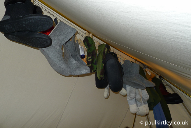 Clothing hung up inside a heated tent