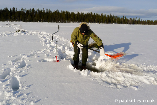 Paul Kirtley moving slush in the arctic