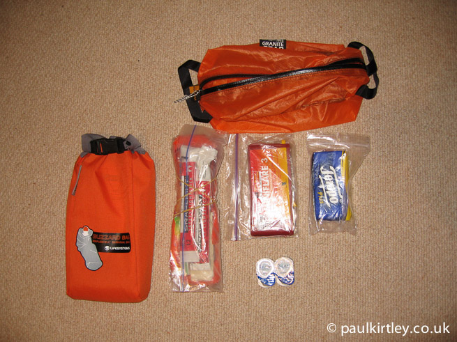 Blizzard bag, Cyalume light sticks, dextrose tablets, flares, spare contact lenses, tissues