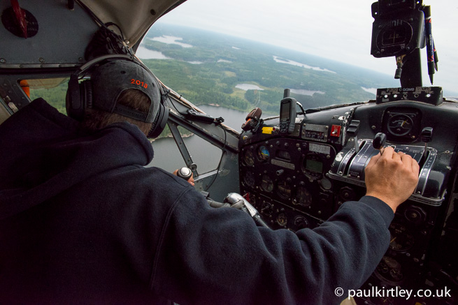 View from inside de Havilliand DHC-2 Beaver floatplane cockpit as it makes a banking turn