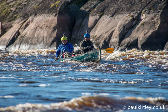 Canoeists with water