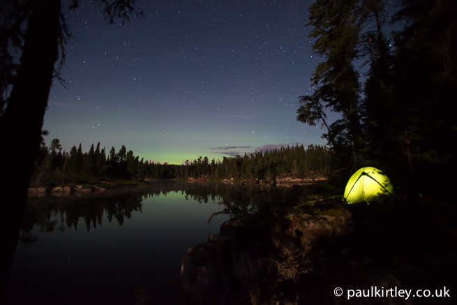 Illuminated tent with stars and aurora
