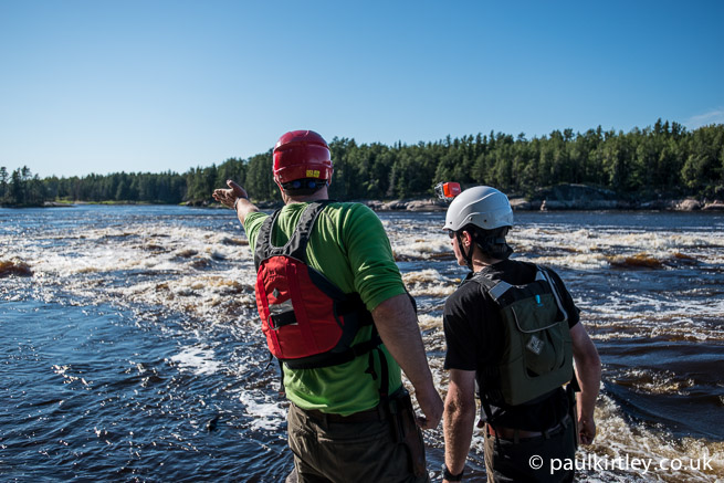 Two guys looking at Meekinako Rapids on the Bloodvein River