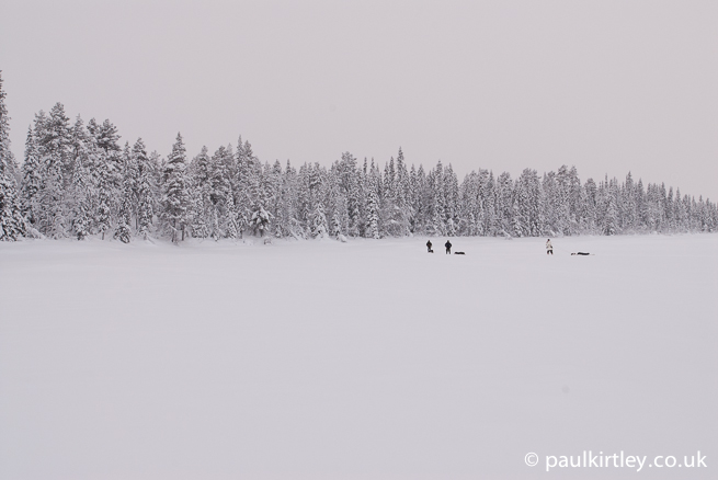 Men walking in snowy wilderness