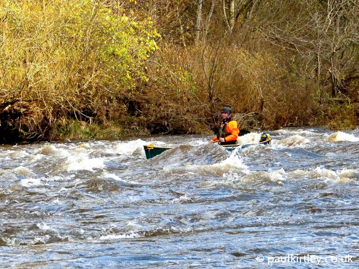 Paul Kirtley paddling canoe on River Eden