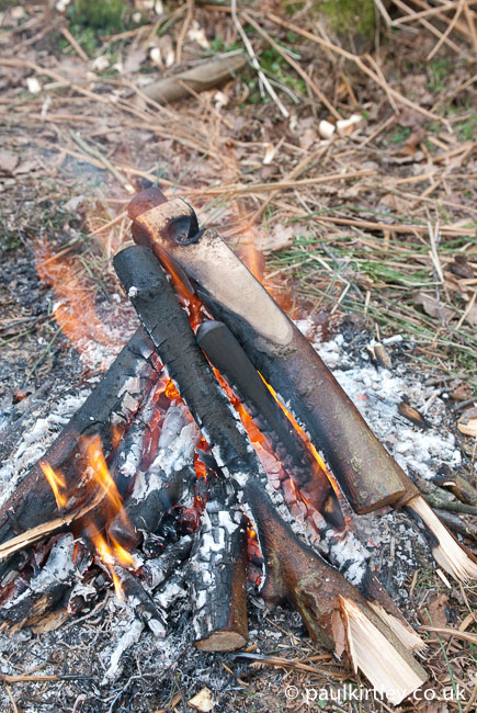 campfire with a bow drill set burning in it