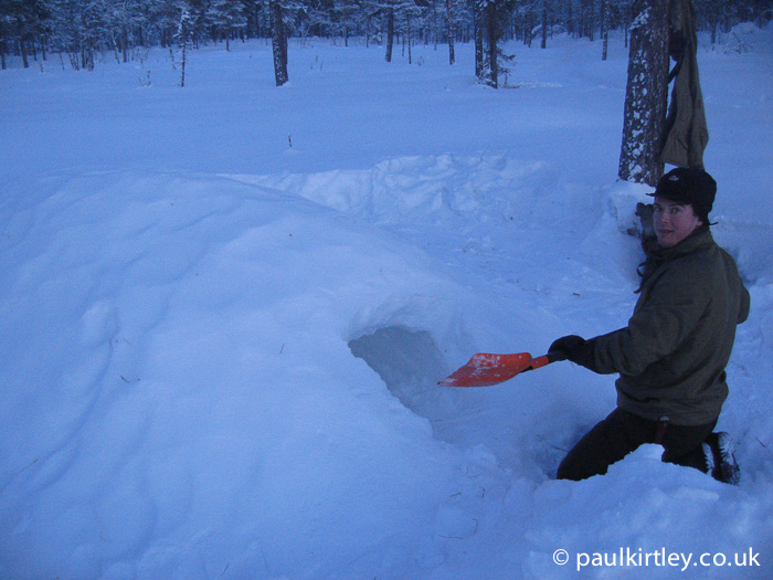 Paul Kirtley digging one man quinzhee snow shelter