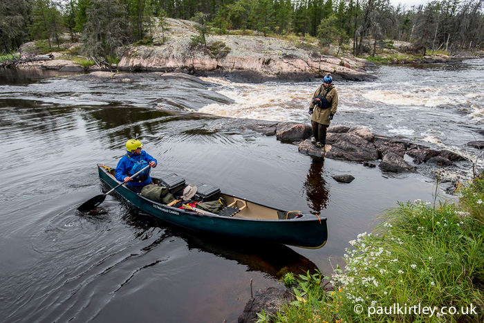 Ray Goodwin paddling tandem expedition boat solo on a wilderness trip in Canada