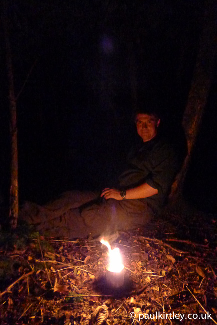Paul Kirtley illuminated by an improvised tin-can candle