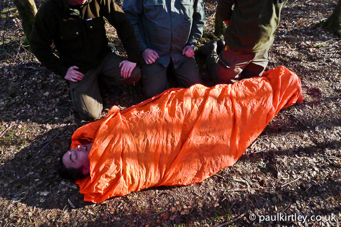Adam Gent in bothy bag on Frontier Bushcraft staff first aid training exercise