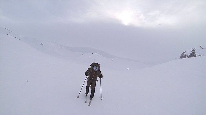 Man skiing in very snowy surroundings in Norwegian hills