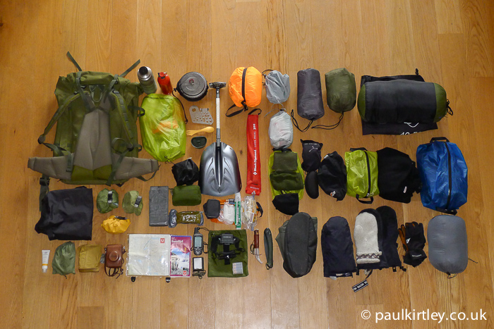 Outdoor equipment for ski touring in Norway, laid out carefully on the floor