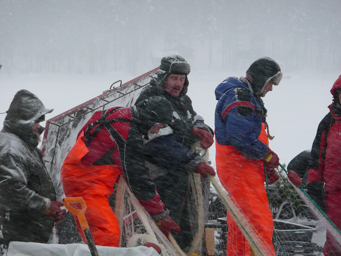 Finnish fisher men in a blizzard