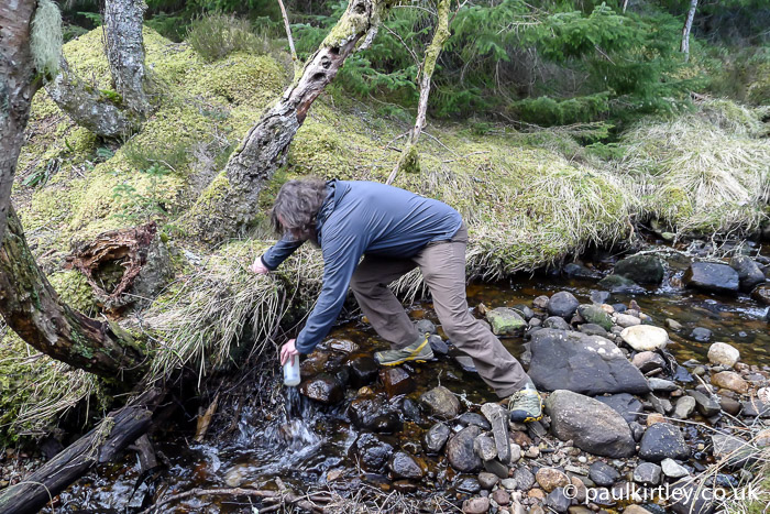 Chris Townsend collecting water from a stream