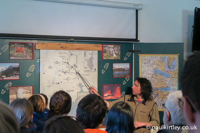 Los Glaciares National Park Ranger pointing at a map during a briefing