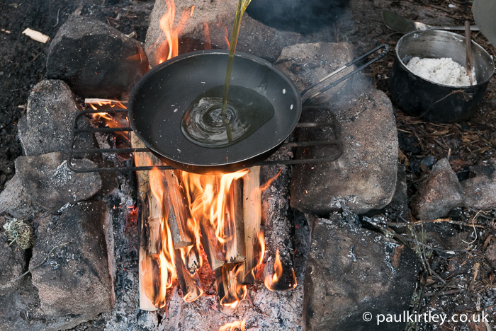 Set the pan over the fire and add some oil.  Don't get it too hot. The olive oil will add great flavour to the bread. Photo: Amanda Quaine