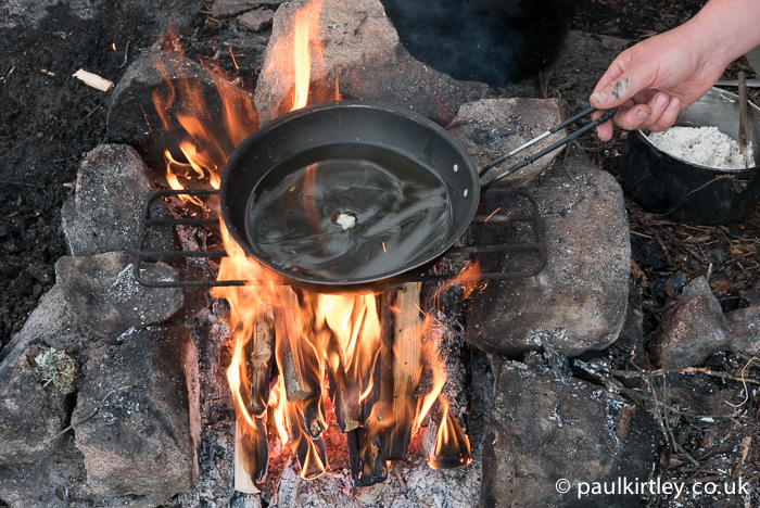 Put a little bit of dough in the oil and wait for it to start sizzling. Photo: Amanda Quaine