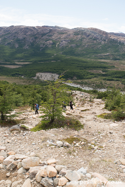 Looking down a mountain trail that is eroded