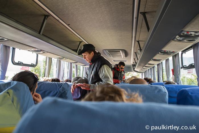 Bus interior with Parque Nacional Los Glaciares officials taking payment of park fees