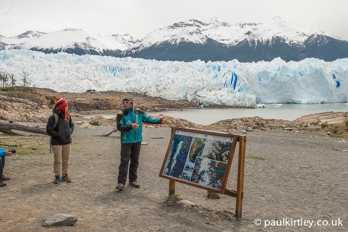 Guide making a presentation on the Perito Moreno glacier, which is in the background