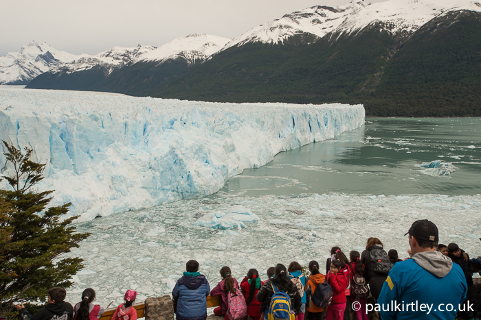 A busy viewing platform in front of the Perito Moreno glacier.