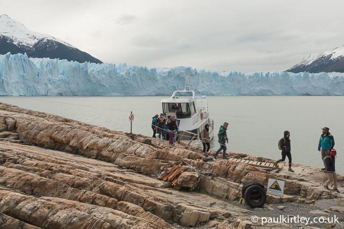Boat moored in front of Perito Moreno glacier