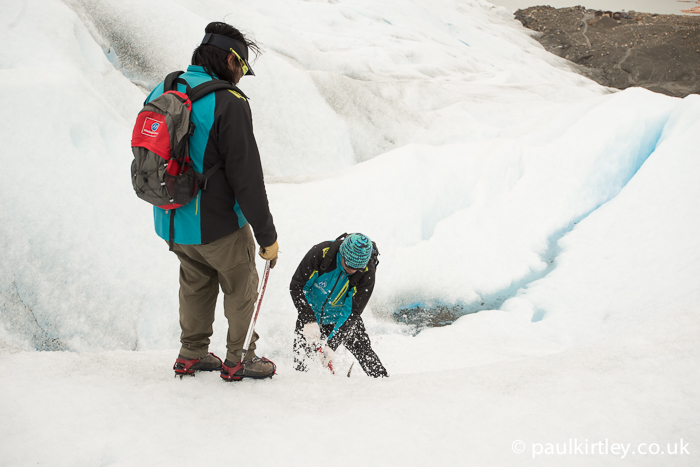 Perito Moreno guide cutting steps with an ice axe