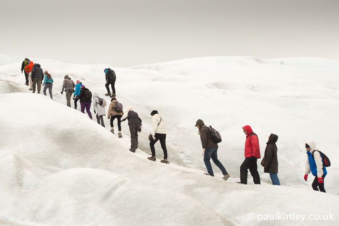 A group of inexperienced people trekking on a glacier