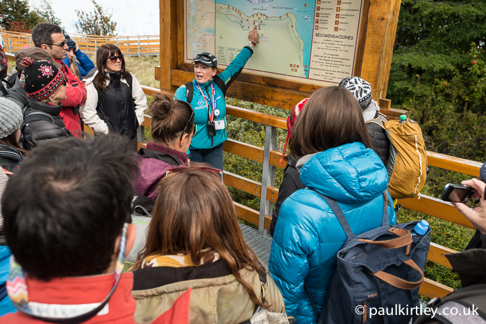 tour guide explaining the walk ways at Perito Moreno glacier using large map on site