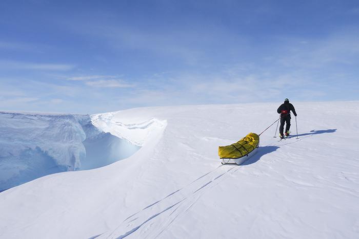 Man hauling pulk in Antarctica