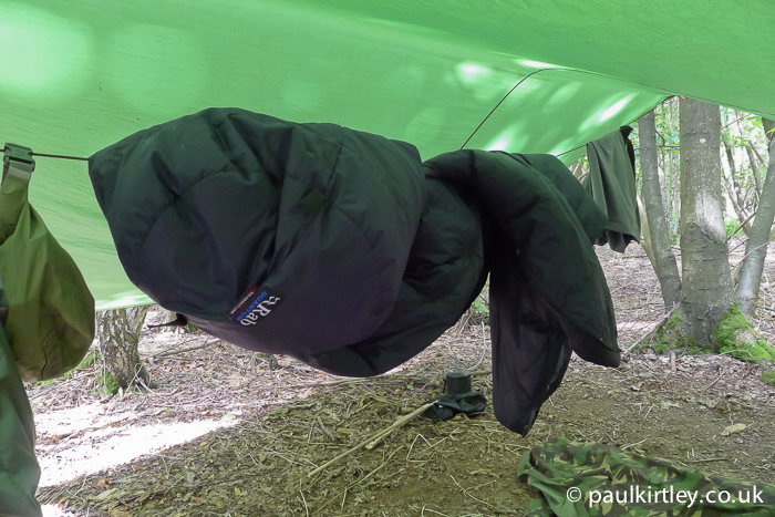 Sleeping bag hanging on line under a tarp
