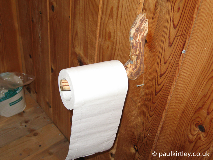 Toilet roll dispenser made from natural stick shape.