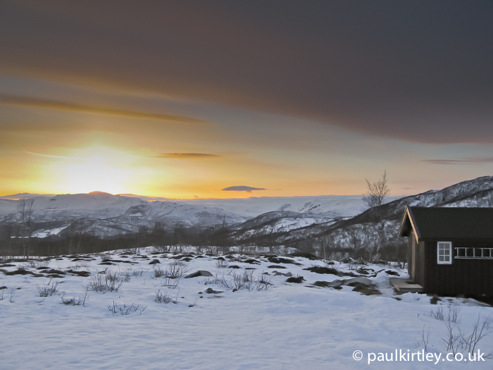 Cabin and sunset in winter mountains Norway