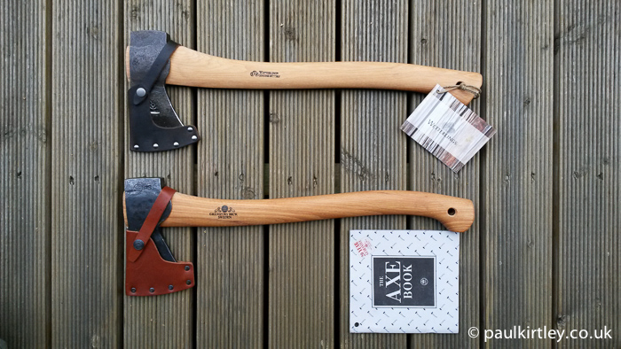 Wetterlings Outdoor Axe and Gransfors Bruk Small Forest Axe together on wooden planks