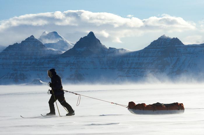 Man pulling a pulk in Greenland